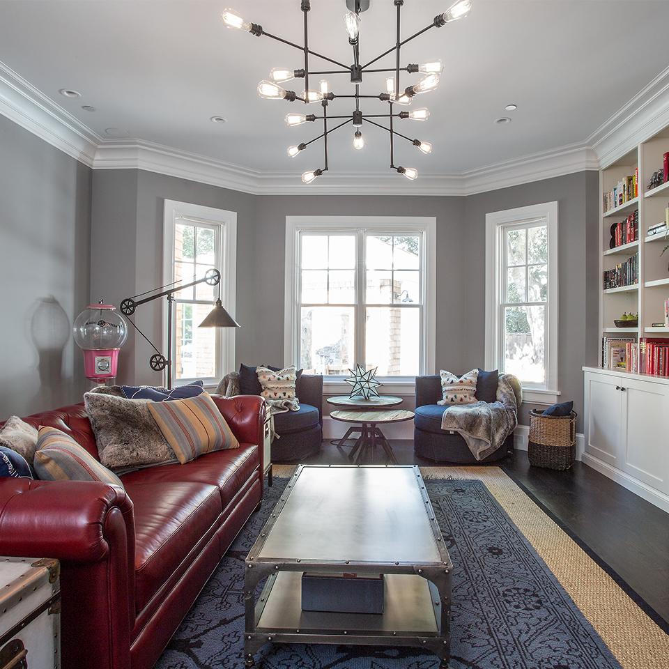 family room red sofa blue rug