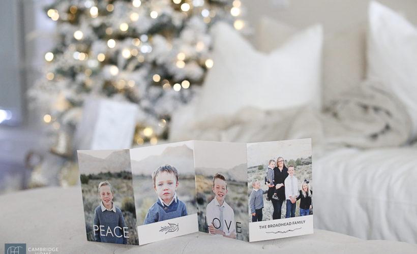 Christmas Card on bench with Christmas tree lights on